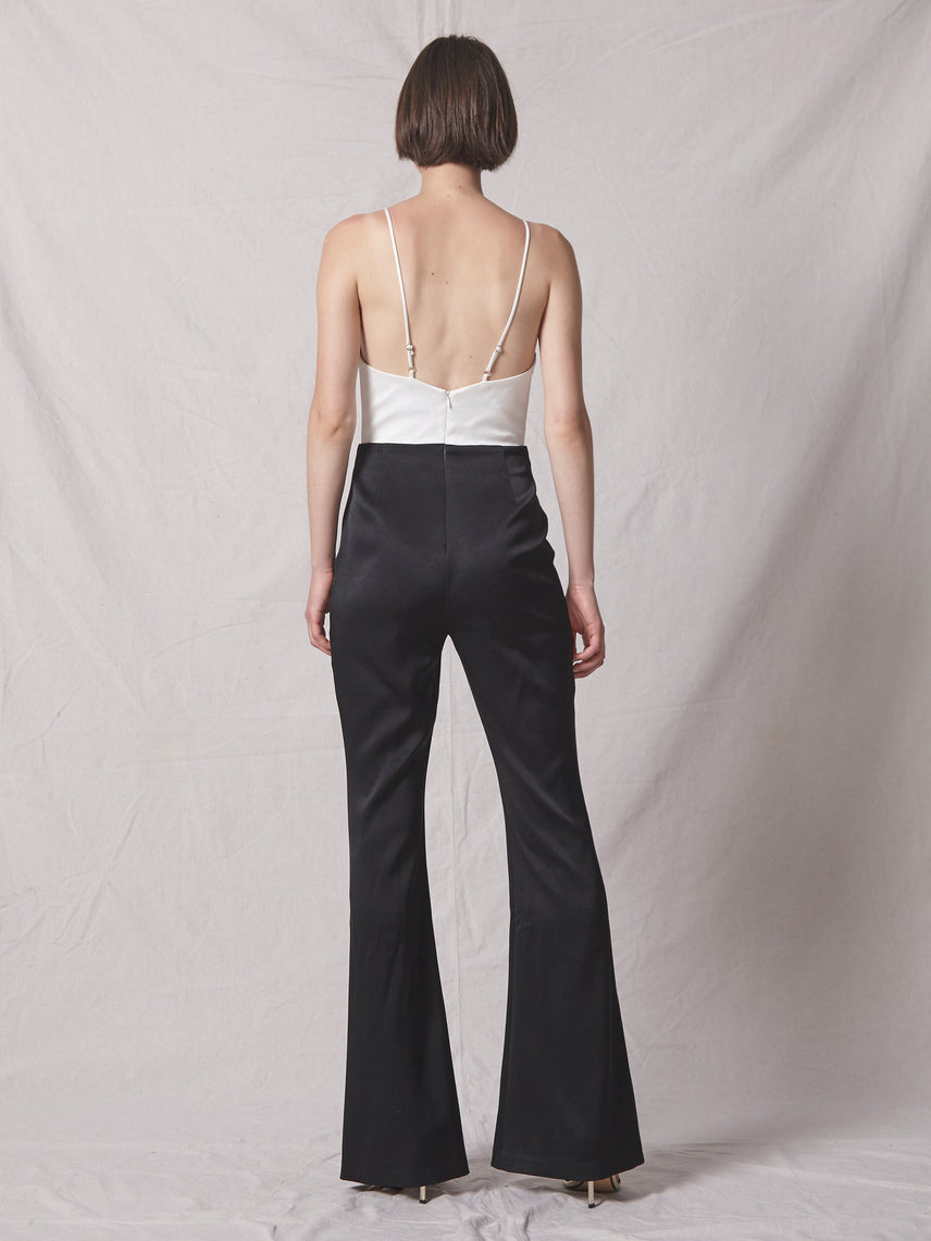 Deep v-neckline 2-tone jumpsuit with exposed back and flared pant leg Alternate