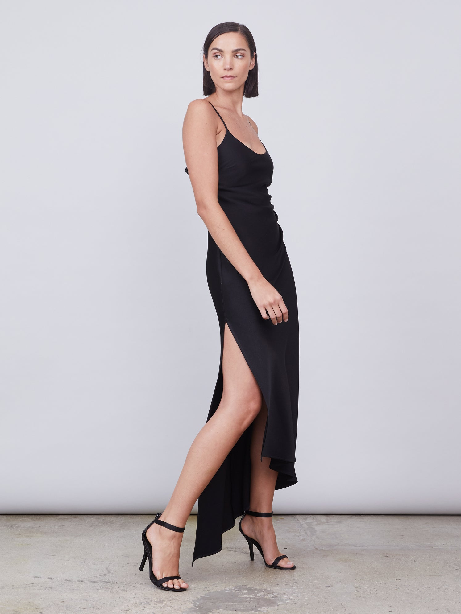 Asymmetrical slip dress with front leg slit and smocked back