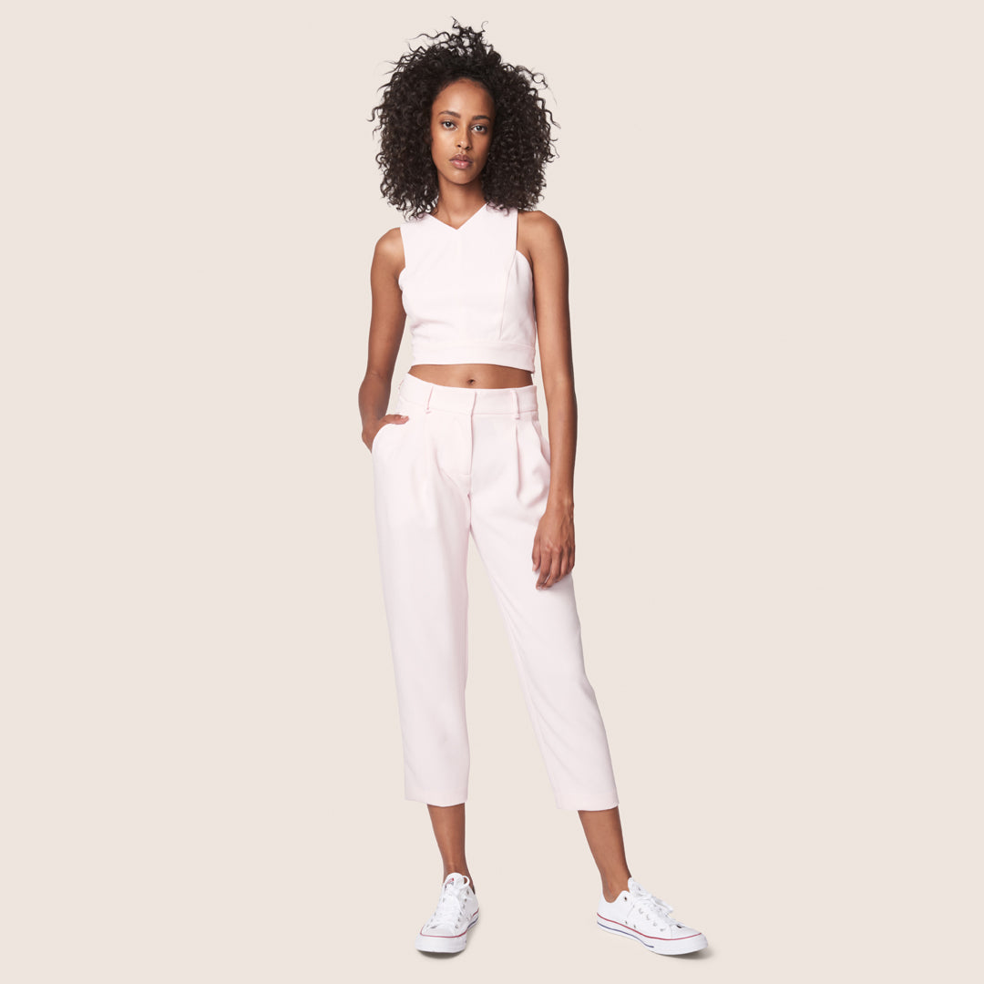 Relaxed pink cropped pant with pleats and matching cross back crop top