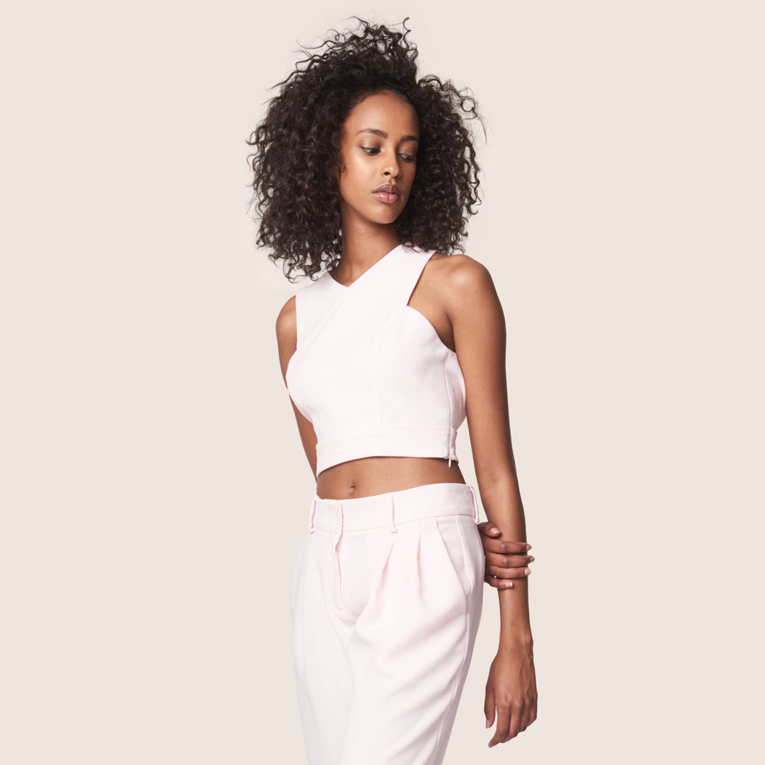 Sleeveless cross back crop top with matching relaxed cropped pleated pants