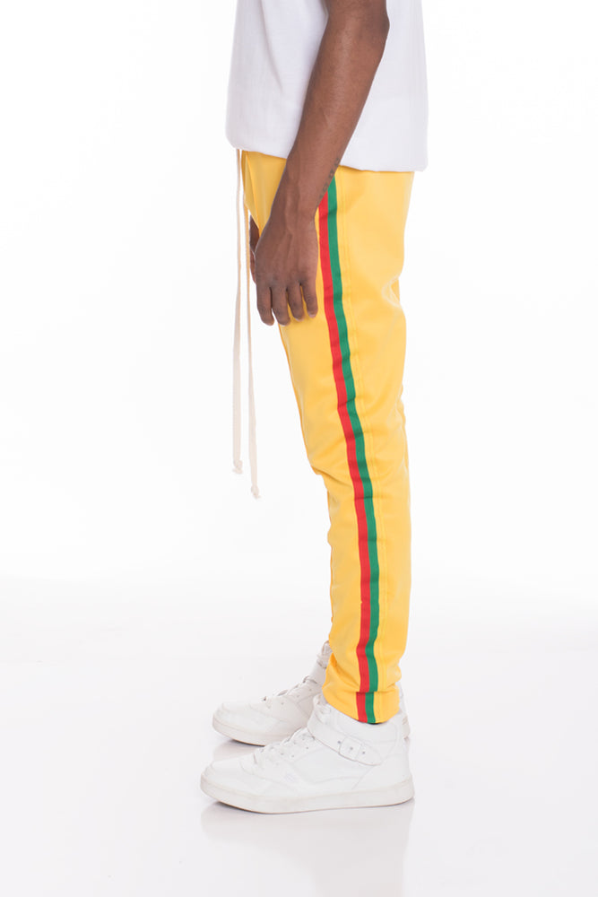 Load image into Gallery viewer, RASTA TRACK PANTS
