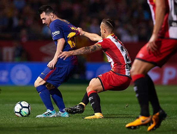 Man marking Messi, winning the battle while losing the war