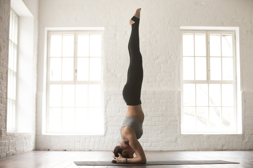 Three Poses to Help Prepare You For a Headstand