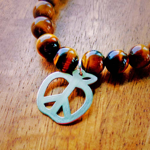 teach peace bracelet close up
