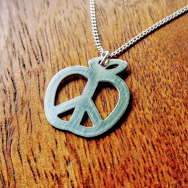 teach peace necklace close up