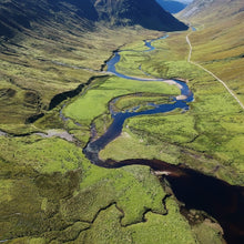 An aerial view of our Scottish Highlands reforestation project. This beautiful lush green valley is just one of the locations where our eco friendly gifts contribute to tree planting and rewilding interventions.