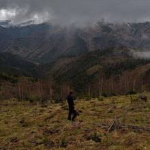 Co-founder Matt of Mossy Earth on location, on a stormy day, at a clear felled area in the Southern Carpathian mountains. Our eco friendly gifts contribute to rewilding projects and reforestation interventions in these beautiful mountains.