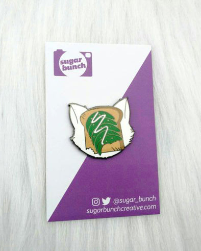 Defaced Cat, kitty with avocado toast on it's face silver hard enamel lapel pin accessory.