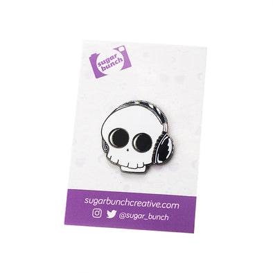 Tone Death skull with headphones black nickel hard enamel lapel pin accessory.