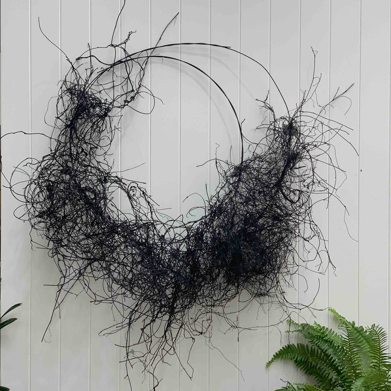 Black Hessian and palm sculpture