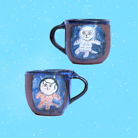 Space Cat Mugs by Lena Wolek