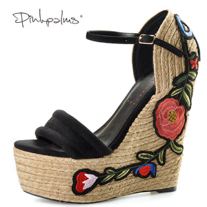 Embroidered suede wedge Sandals