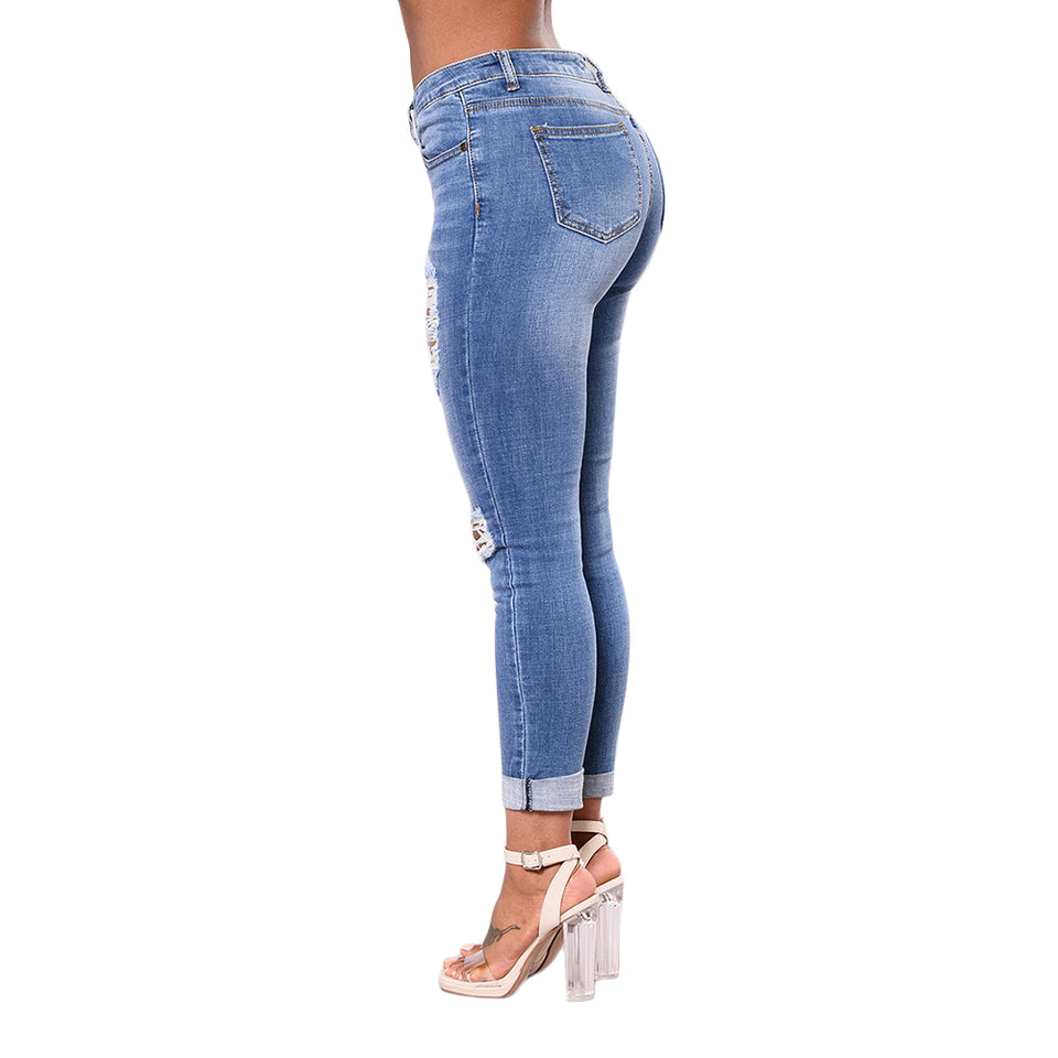 Ripped denim low waist jeans