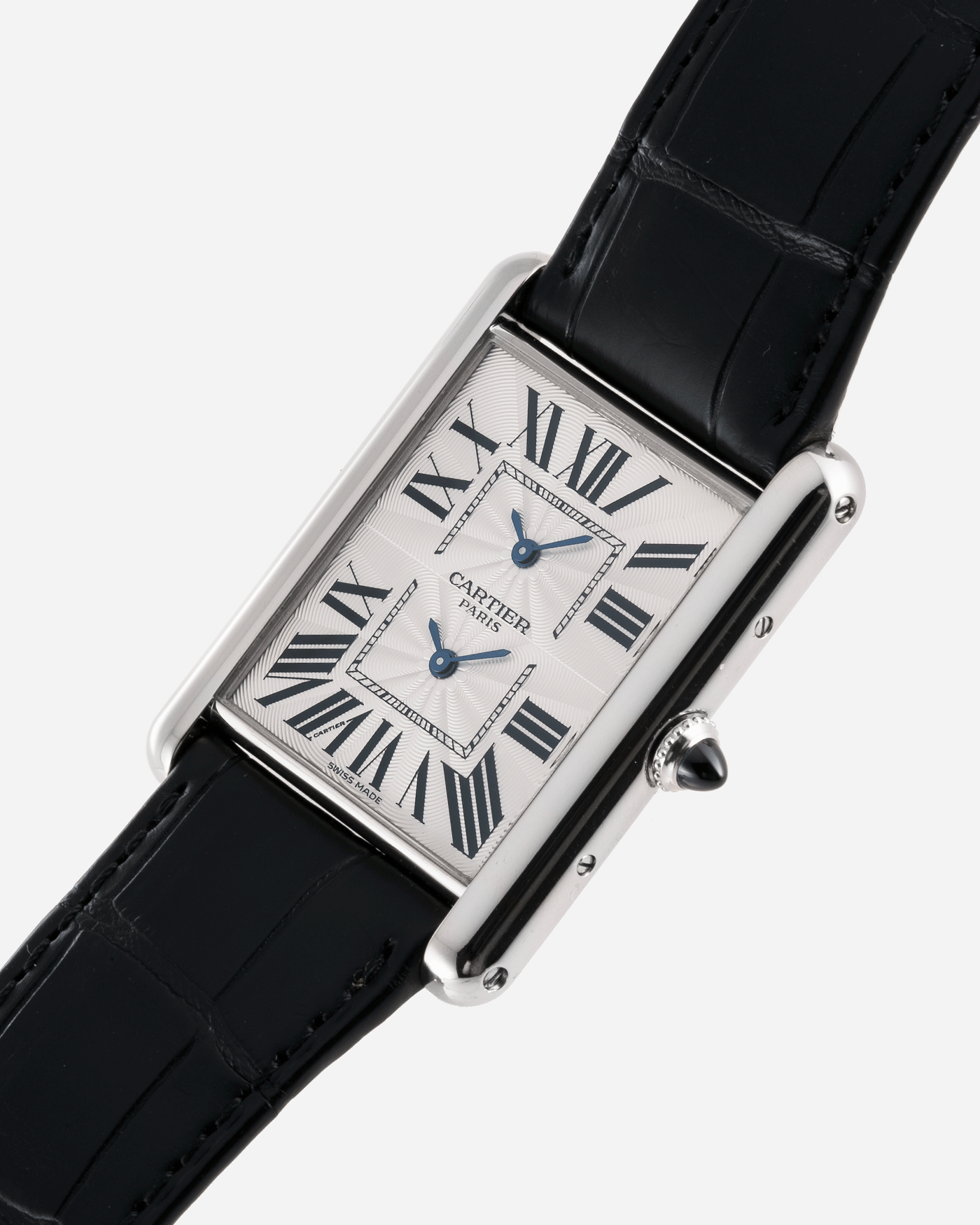 Brand: Cartier Year: 2010 Model: CPCP Tank Two Time Zone Reference: 2917 Material: 18k White Gold Movement: Piaget-Based Manually Wound Cal. 9901 MC Case Diameter: 29.3mm width, 38.3mm length Strap: Cartier Black Alligator Strap with 18k White Gold Cartier Deployant Clasp