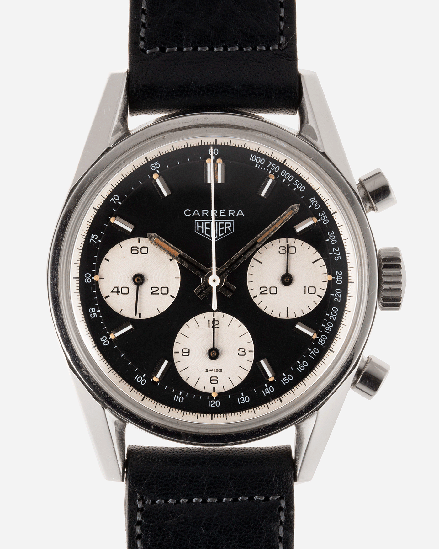 Brand: Heuer Year: 1960's Model: Carrera Reference Number: 2447NST Material: Stainless Steel Movement: Valjoux 72 Case Diameter: 36mm Lug Width: 18mm Bracelet/Strap: Accurate Form Navy Blue Calf