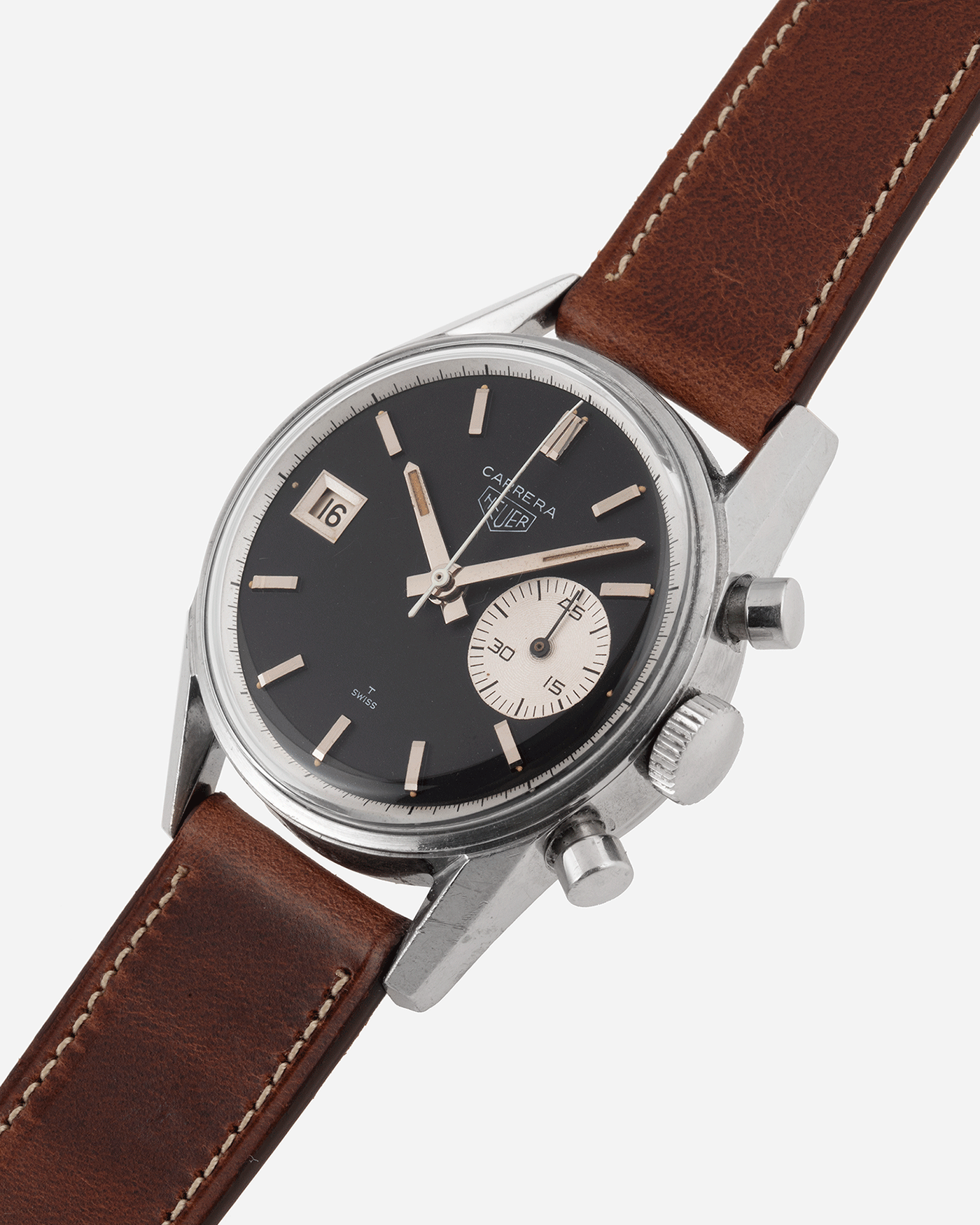 Brand: Heuer Year: 1960's Model: Carrera Reference Number: Dato 45 Ref. 3147N Serial Number: 127655 Material: Stainless Steel Movement: Landeron 189 Case Diameter: 35mm Lug Width: 18mm Bracelet/Strap: Nostime Tobacco Horween Shell Cordovan