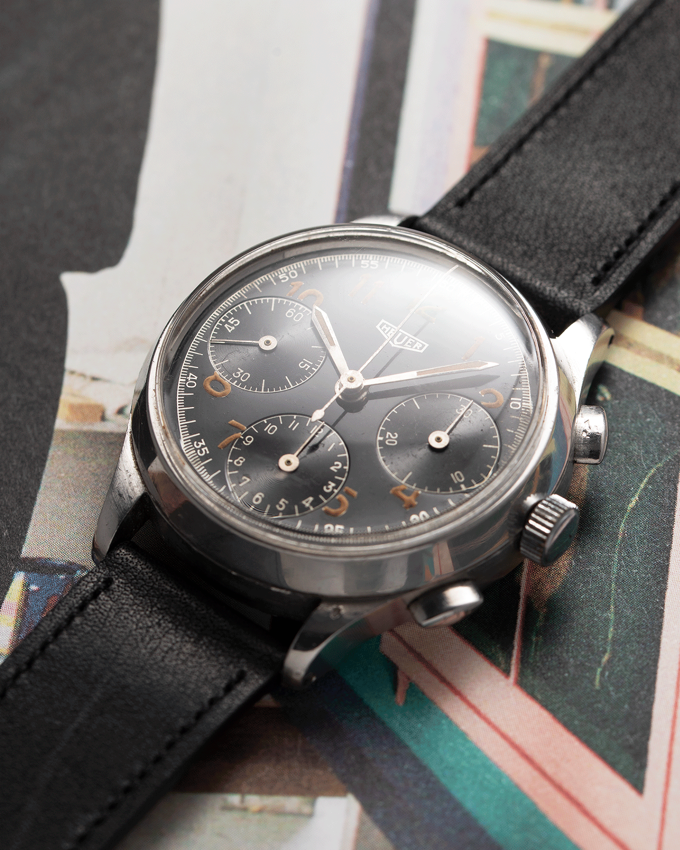 Brand: Heuer Year: 1940's Reference Number: 345 Material: Stainless Steel Movement: Valjoux 71 Case Diameter: 36mm Lug Width: 18mm Bracelet/Strap: Nostime Black Calf
