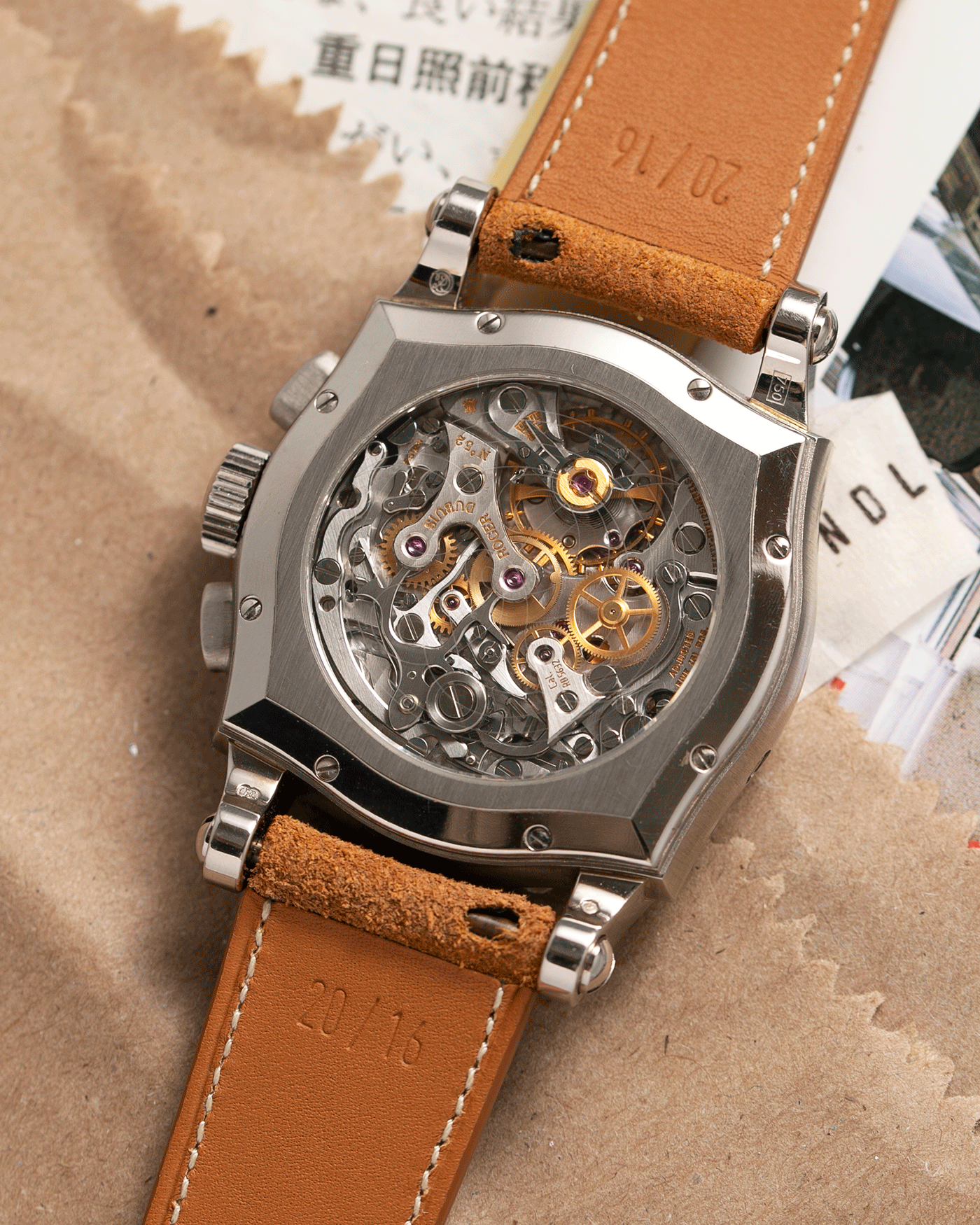 Brand: Roger Dubuis Year: 2000's Model: Sympathie 37 Perpetual Chronograph Material: 18k White Gold Movement: Cal RD 5637 Case Diameter: 37mm Strap: Nostime Sand Tan Suede Calf with 18k White Gold Roger Dubuis Tang Buckle
