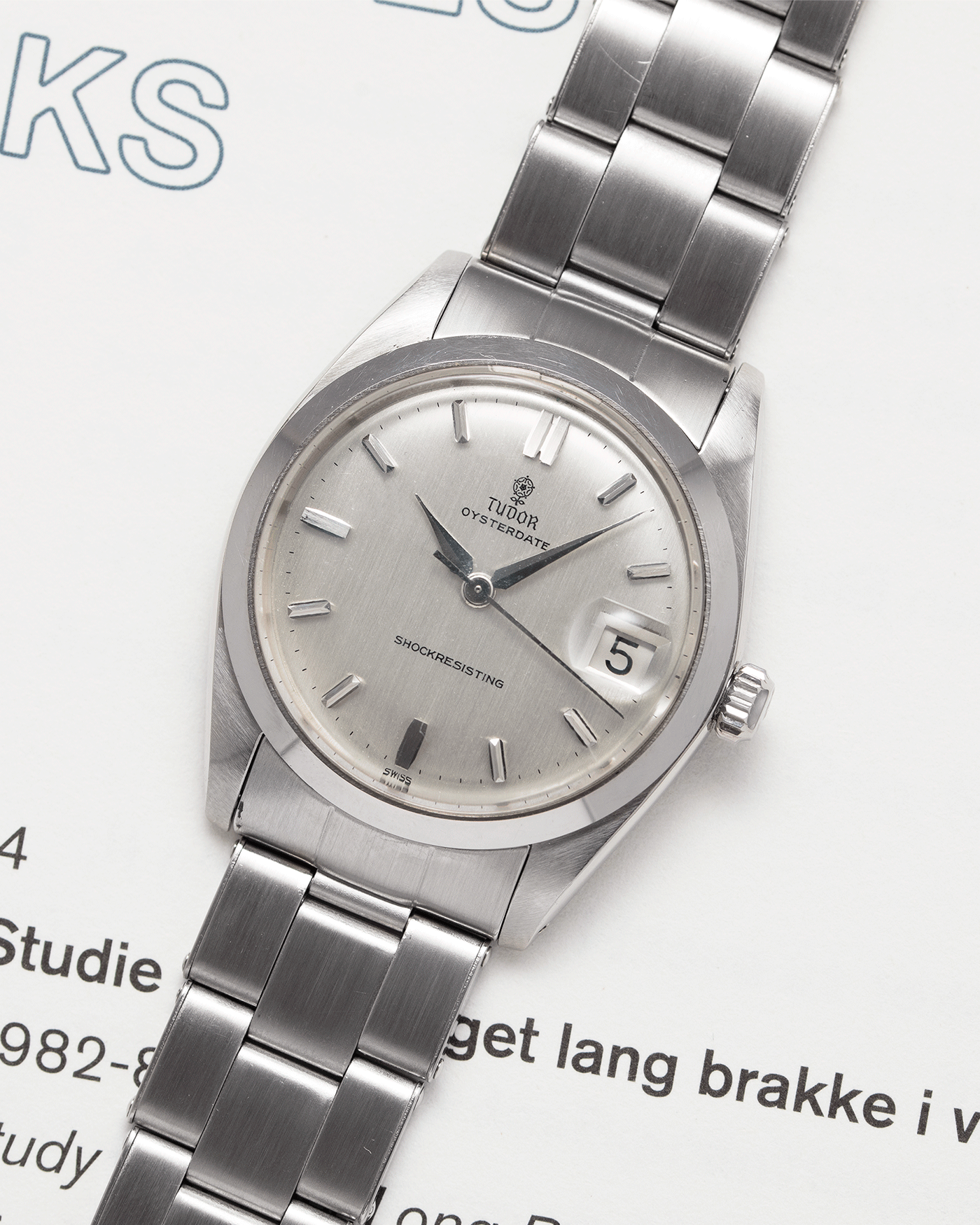 Brand: Tudor Year: 1964 Model: Oysterdate Reference Number: 7962 Serial Number: 447XXX Material: Stainless Steel Movement: Cal. 2403 Case Diameter: 34.5mm Lug Width: 19mm Bracelet/Strap: 19mm Rolex Rivet Bracelet with 57 endlinks, stamped 3.64