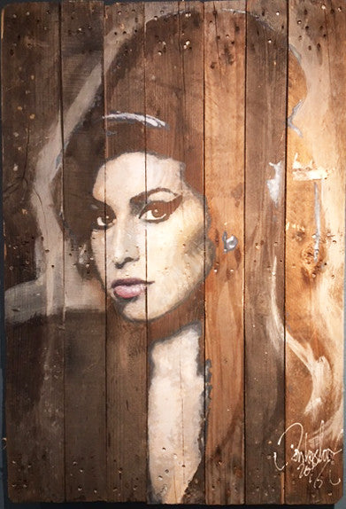 Amy Winehouse on an antique wooden pallet