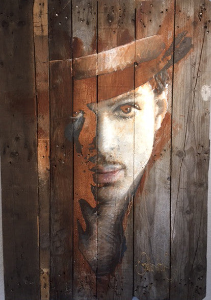 Prince on antique wooden pallet