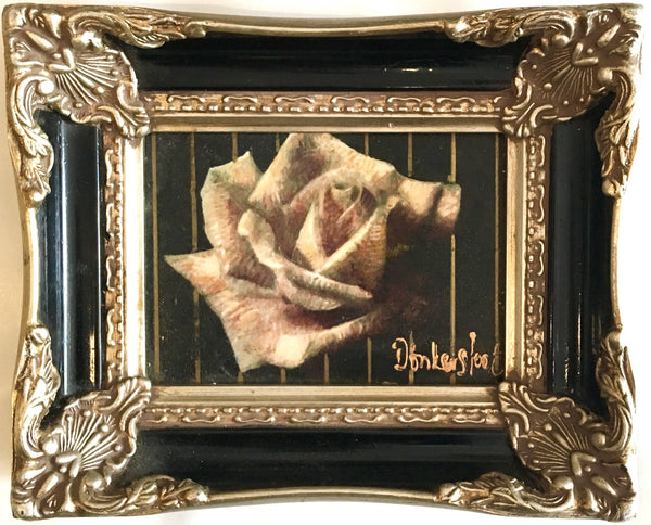 Rose in black frame