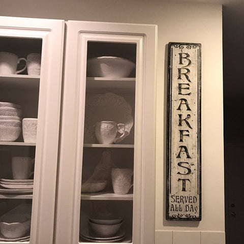 Breakfast Vertical Sign beside Cabinet
