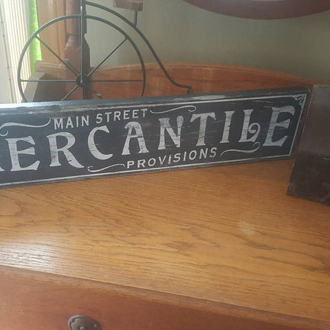 Mercantile Sign on wood desk