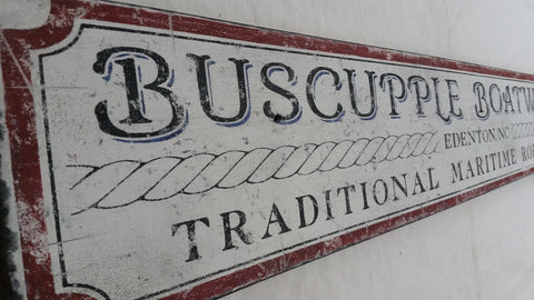 Closeup of Buscupple Boatworks sign