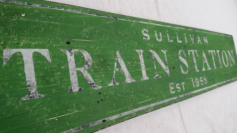 Green Train station sign