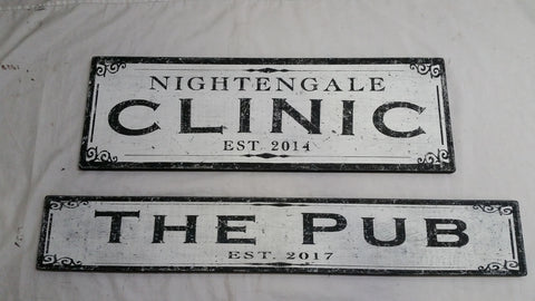 Clinic and The Pub wood signs