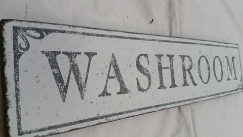 Washroom sign with gray