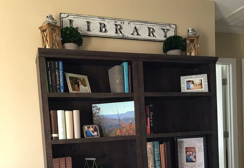 Library Sign above wood shelf