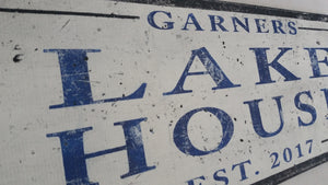Navy blue lake house sign side shot