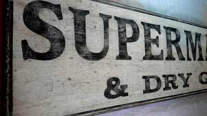 Close up of SuperMarket wood sign