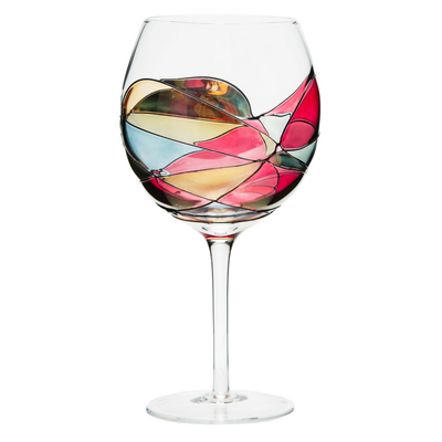 Luxury hand-painted balloon wine glass inspired by the designs of Antoni Gaudi and Sagrada Familia. White background. Cornet Barcelona