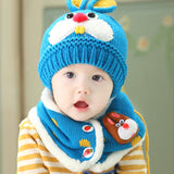 Baby wearing blue hat and scarf set