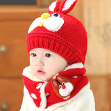 Baby wearing red hat and scarf set
