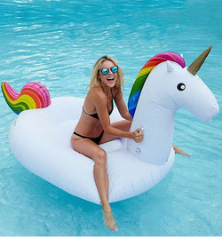 Woman sitting in Unicorn Swimming Pool Float