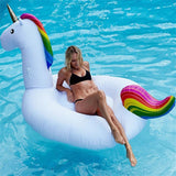 Woman lying in Unicorn Swimming Pool Float