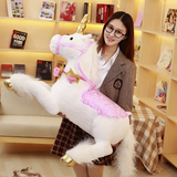 woman holding giant unicorn stuffed animal