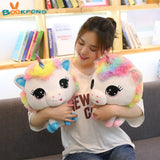Woman holding Rainbow Unicorn Soft Toys