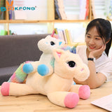 Unicorn Stuffed Plush Toy Pink and Blue with Child