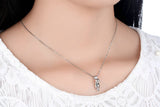 Sterling Silver Cat Necklace worn by woman