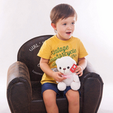 Boy holding LED Glowing Teddy Bear