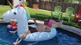 Man lying in Unicorn Swimming Pool Float