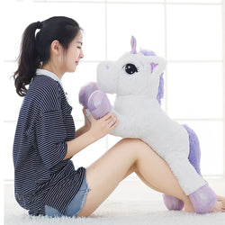 Unicorn Stuffed Toy with Woman