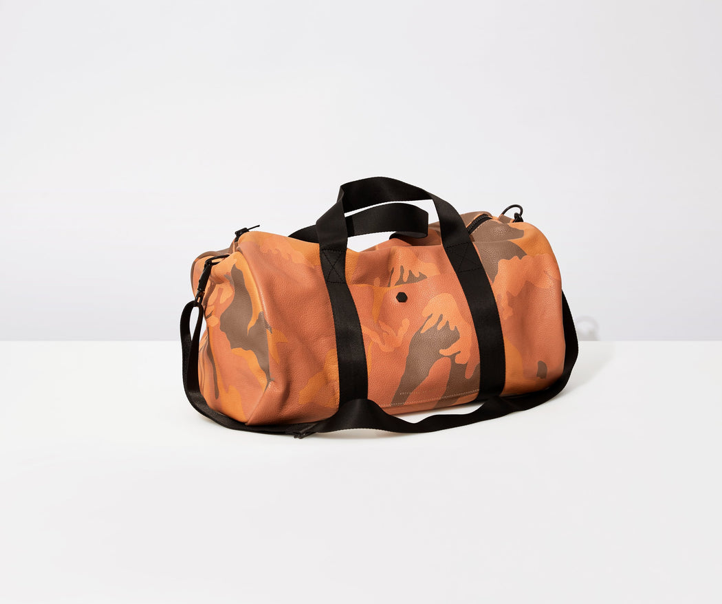 AMPERSAND AS APOSTROPHE fashionable orange camo cantaloupe summer leather duffle women's men's nylon webbing shoulder strap lightweight twin carry handles large everyday travel bag