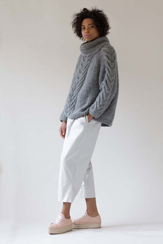 cable sweater white pants