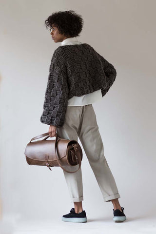 cable sweater brown leather bag